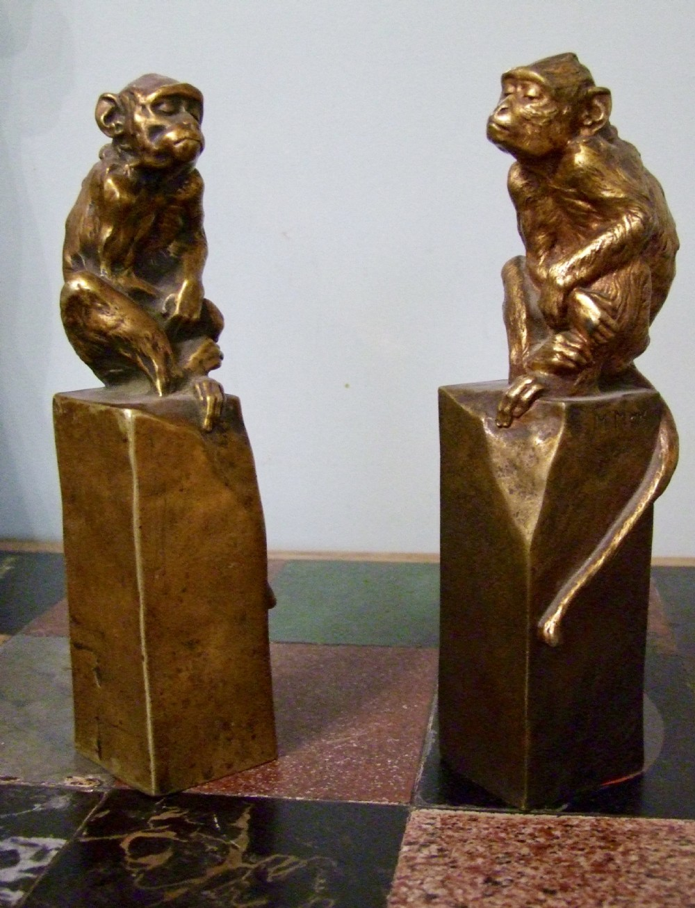 a pair of gilded bronze monkeys sat on a rock by french sculptor maurice roger marx circa 1900