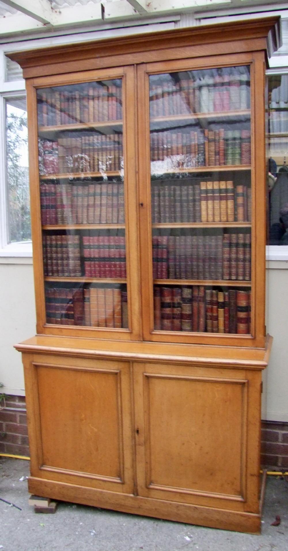 19th century cupboard bookcase in golden oak