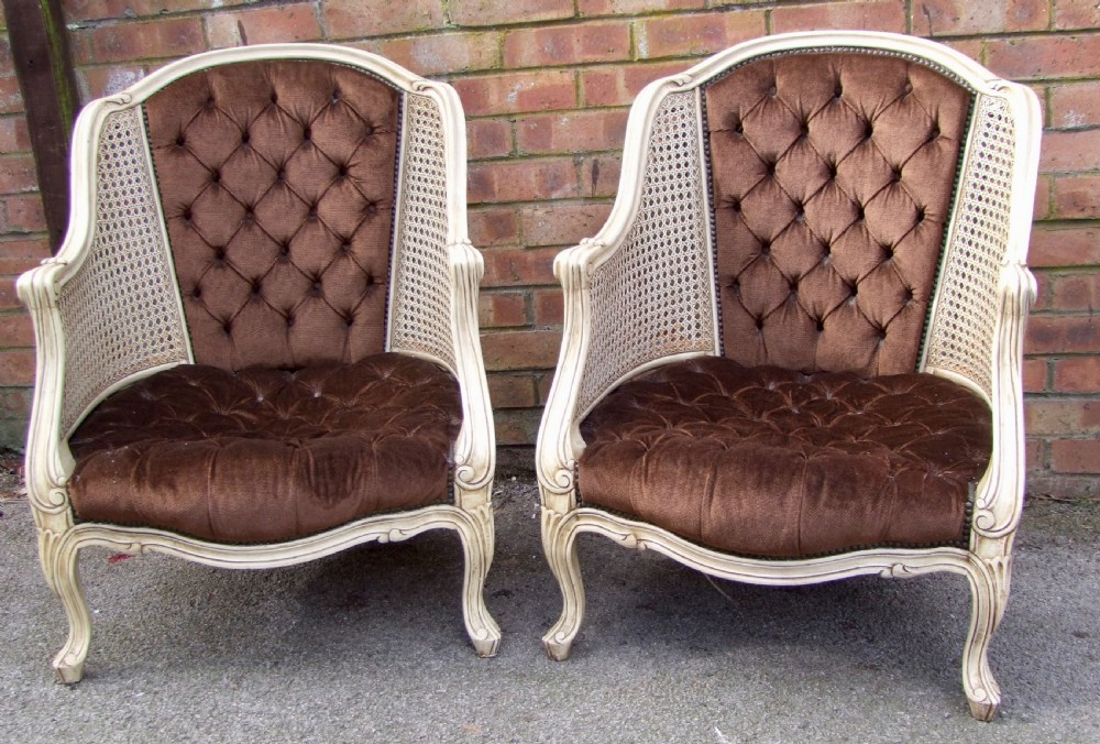 pair of carved wood and gesso double caned salon chairs