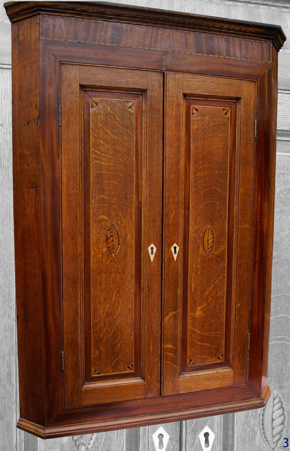 oak and mahogany collector's cupboard circa 1810