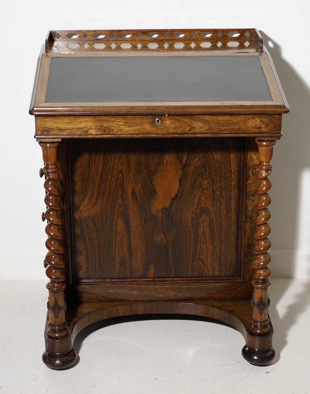 a superb victorian quality rosewood davenport with satinwood interior