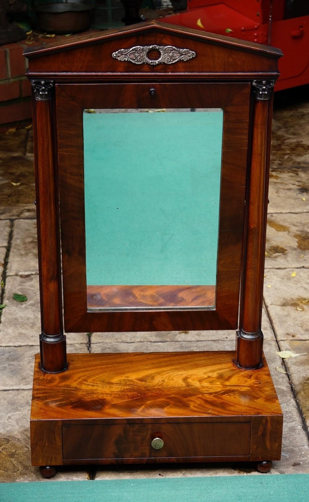 finely figured mahogany brass mounted single drawer swing mirror circa1850