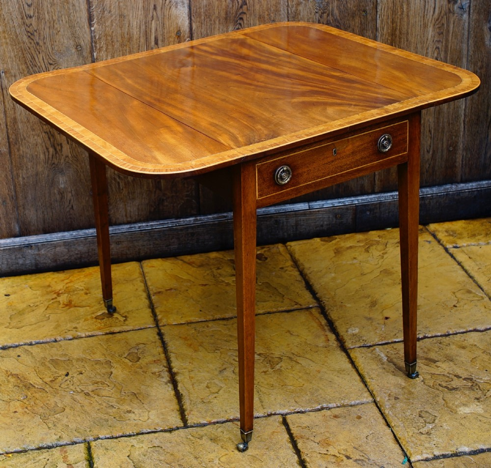 a very attractive good quality mahogany and inlaid pembroke table on square tapering legs terminating on