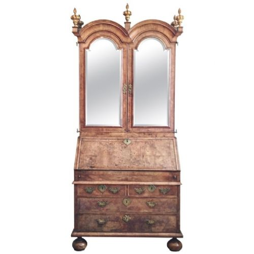 a queen anne fully fitted figuredwalnut double dome bureau bookcase