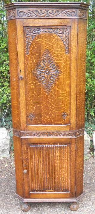 carved oak standing corner cupboard