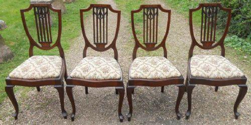 set of four edwardian inlaid mahogany salon chairs