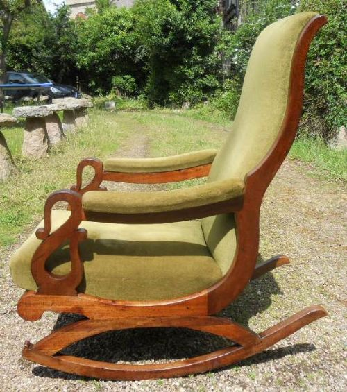 victorian upholstered rocking armchair
