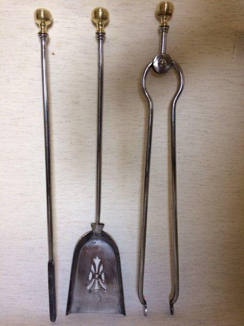 a good quality set of steel brass fire irons